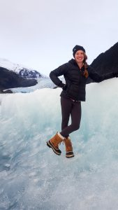 Picture of Ashley Rossin standing on ice in the mountain.