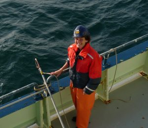 Picture of Maura Thomas in a hardhat on the deck of a boat.