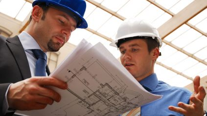 two professional engineers looking at plans