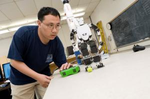 student working in robotics lab