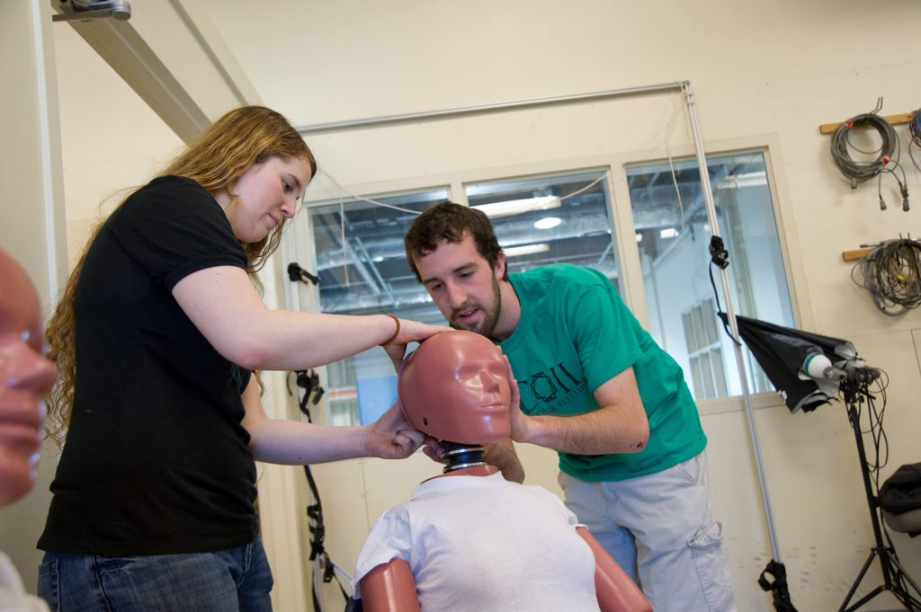 students working with manican to research head injury