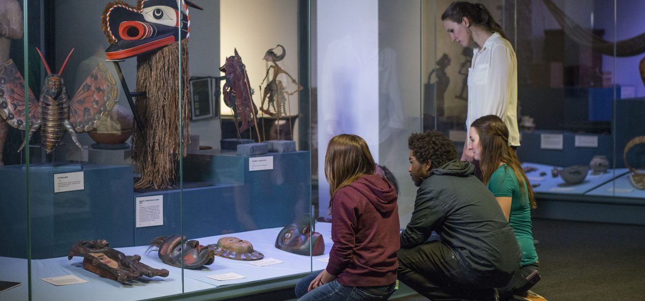 students viewing an exhibit at the hudson museum