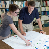 researchers with map