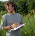 student taking notes in estuary