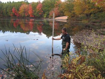 researcher measuring water depth