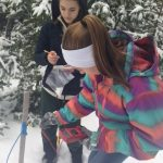 Students collecting snow