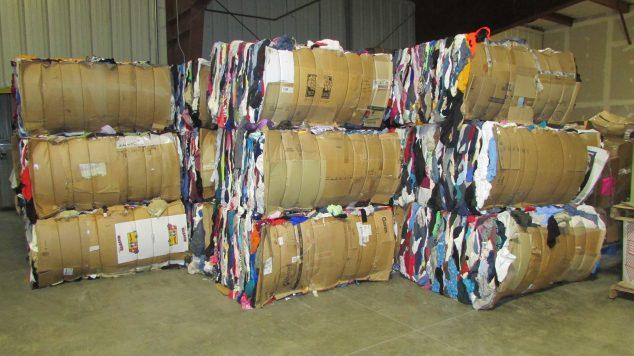 Image of stacked baled clothing