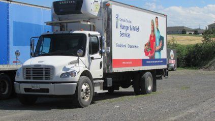 "Truck with text that reads ""Hunger and Relief Services"""
