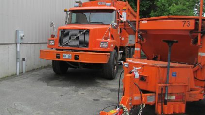 Image of orange garbage truck