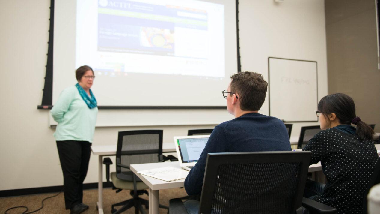 Professor lectures graduate students