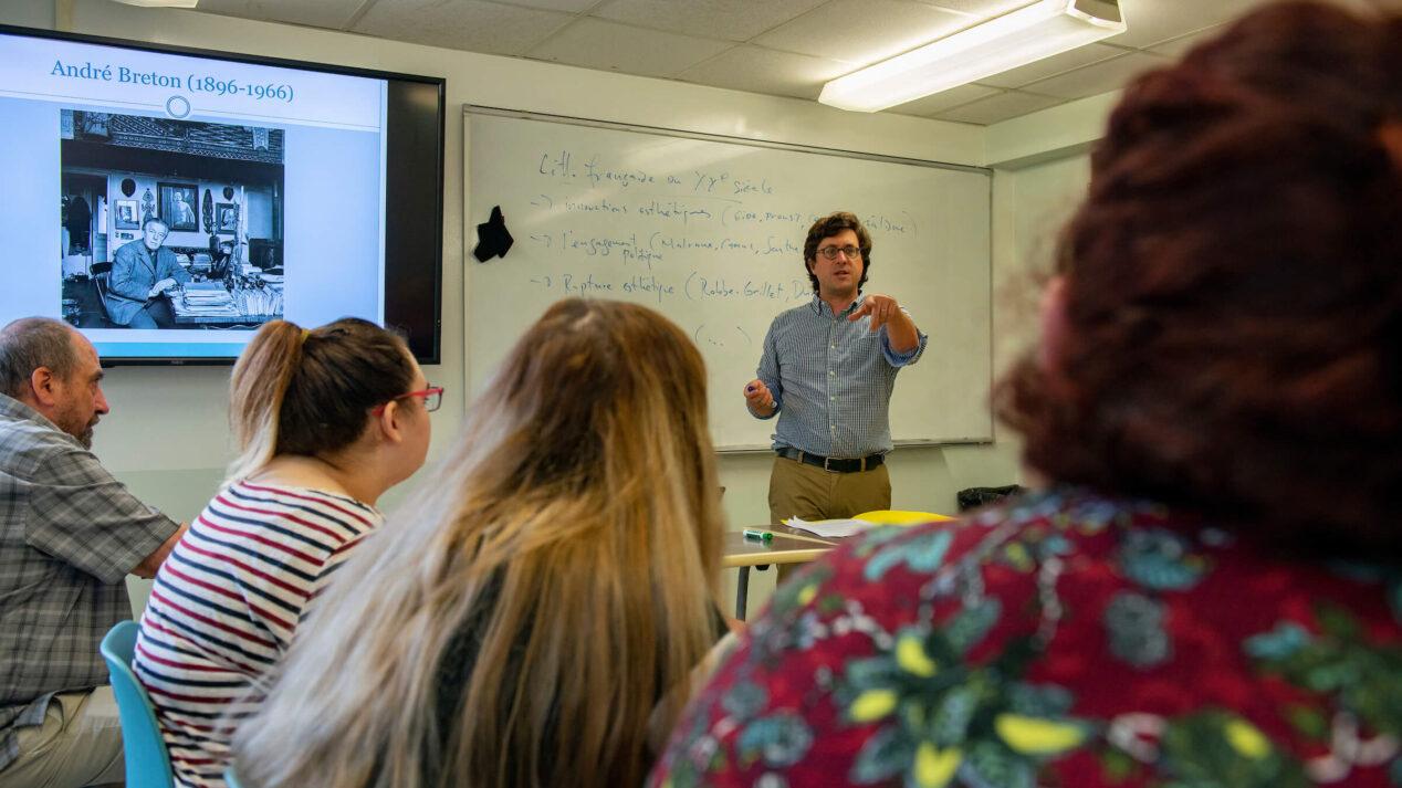 professor leading classroom discussion