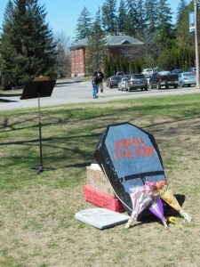 mock funeral for affordable education on the University of Maine campus