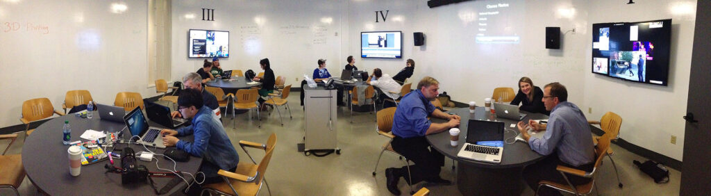 New Media students and faculty in an active learning classroom