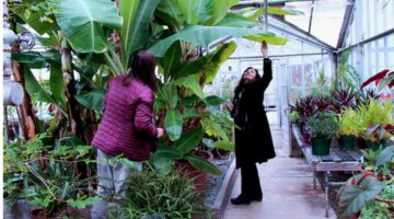 Joline Blais and Stephanie Burnett in the Roger Clapp Greenhouse