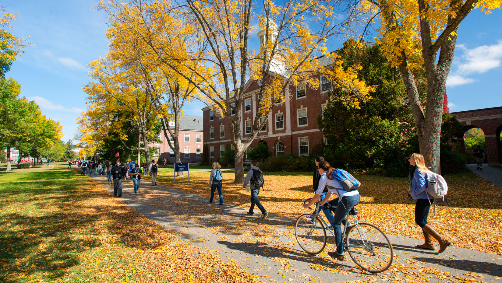 Students walk along the Mall during fall