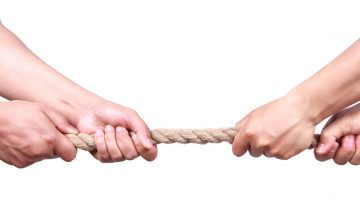 Hands pulling on a rope