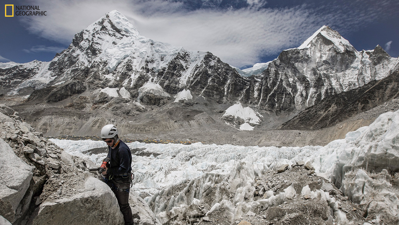 Peter Strand taking a sample from a rock outcrop next to the Khumbu Icefall above Everest Base Camp