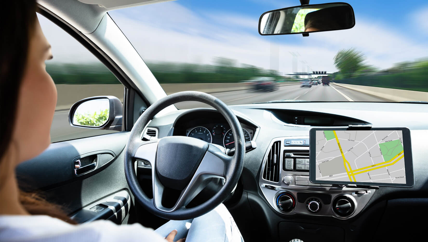 Woman in a self-driving car