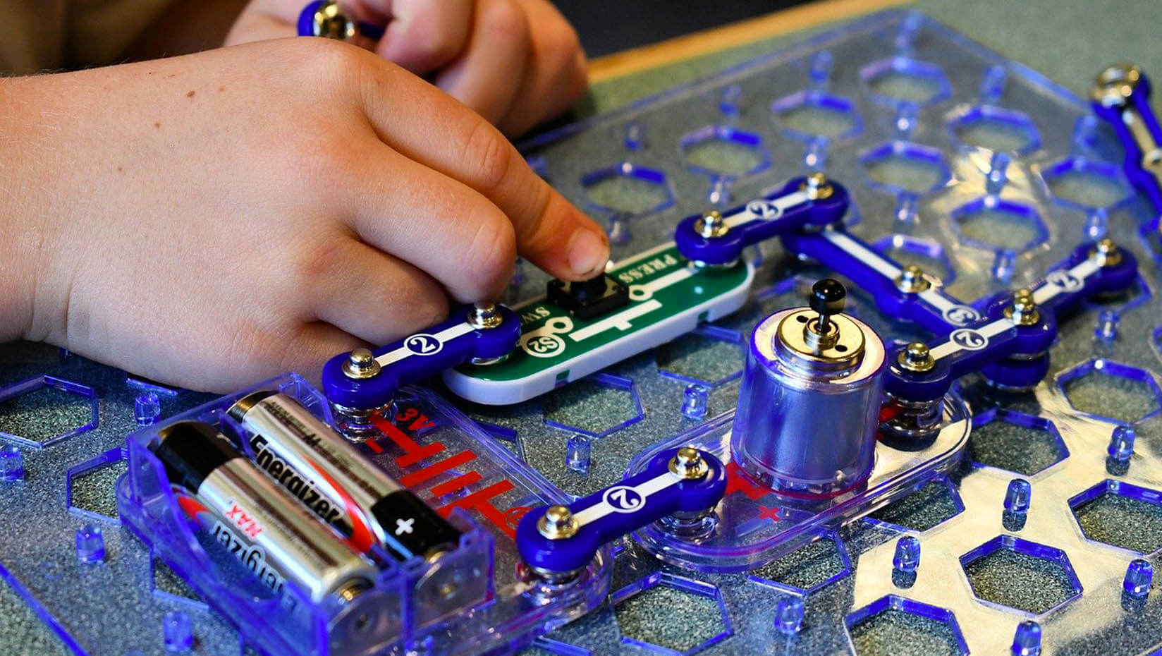 Student working with a circuit