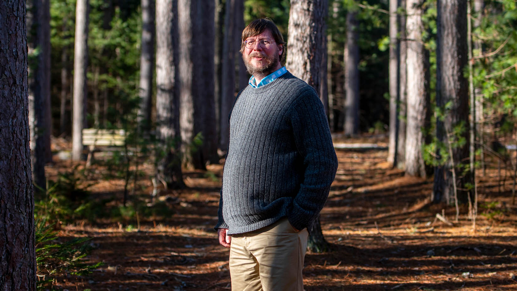 Brian McGill standing in the forest