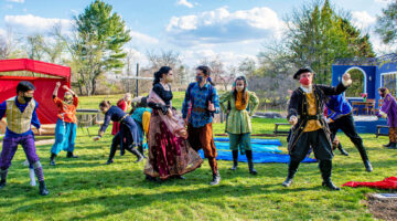 UMaine students perform in a garden on campus.