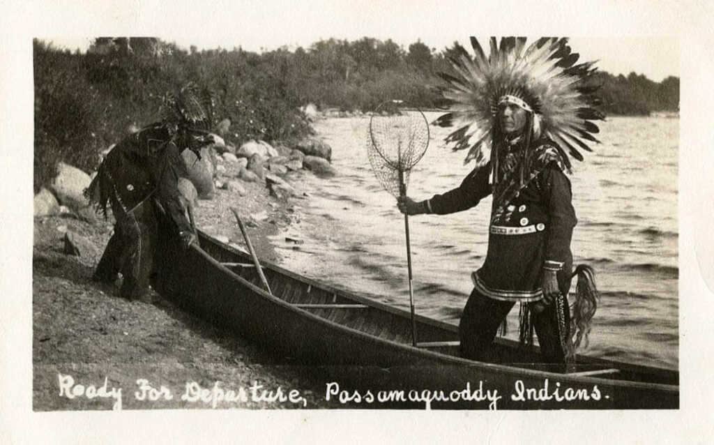 Two Native Americans in a canoe