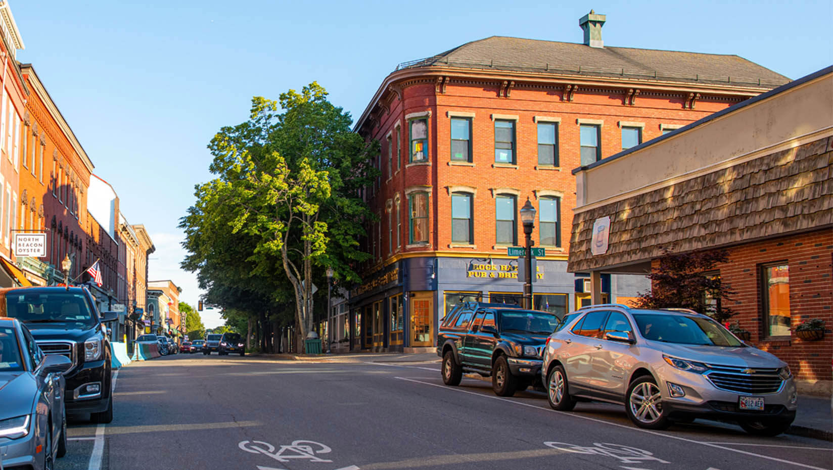 A photo of a street lined with businesses in Maine