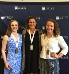 UMaine students receiving an award