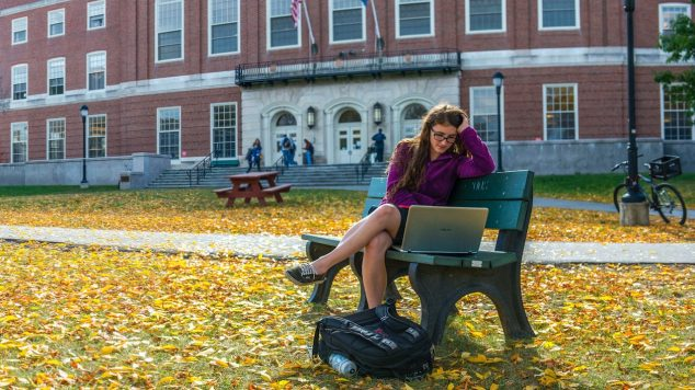 student sitting outside fogler library