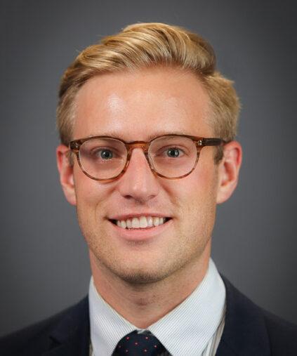Professor Nick Micinski on a grey background