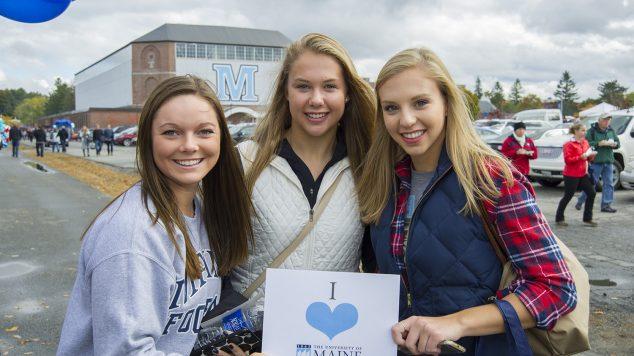 Students holding I love UMaine sign