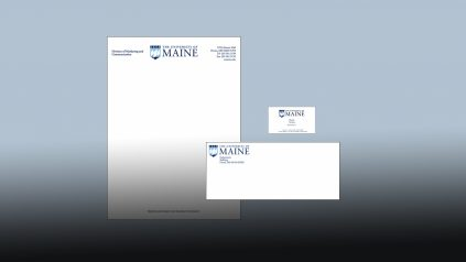 Collage of UMaine envelope, letterhead and business card