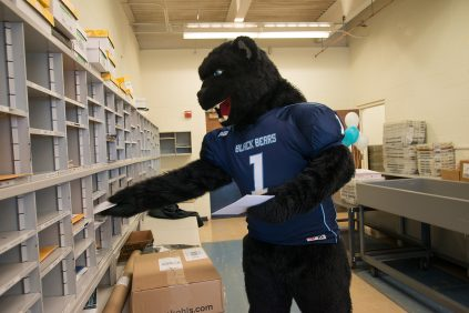 Bananas bear mascot delivering mail Printing and Mailing Services University of Maine