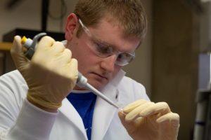Graduate student James Elliot in lab