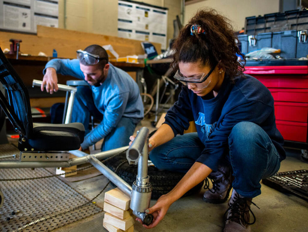 Two students working on a mechanical engineering project