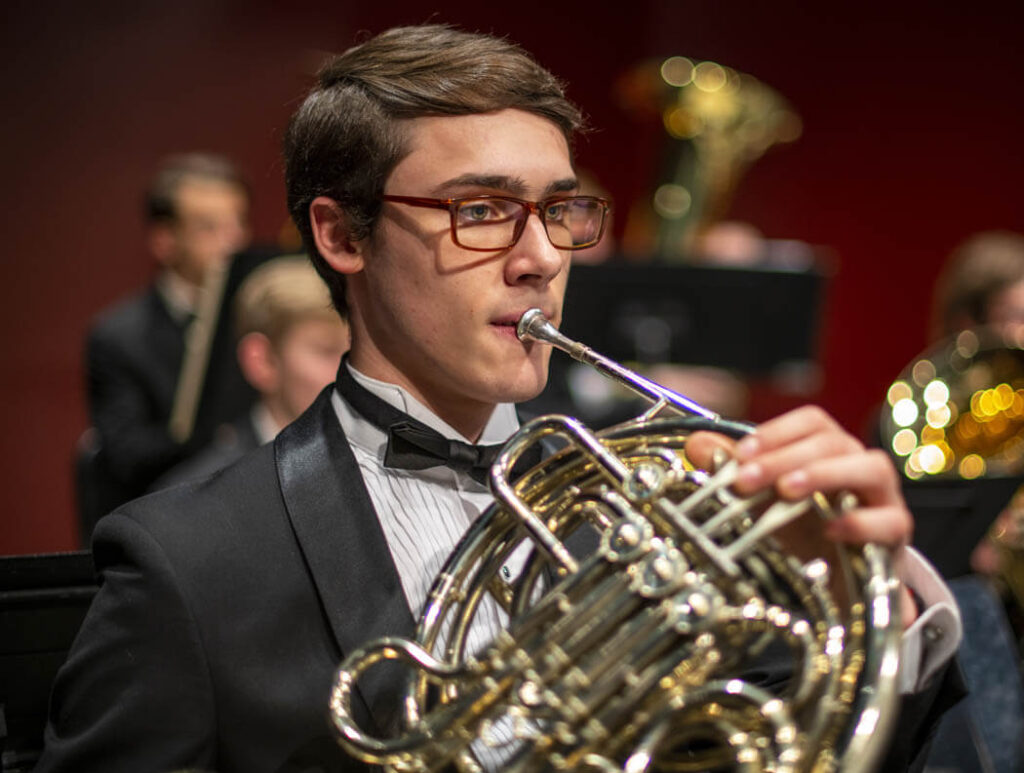 Musician playing a French horn