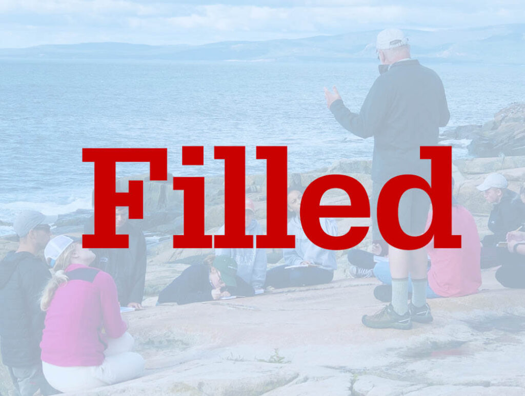A professor teaches students on Maine's coast