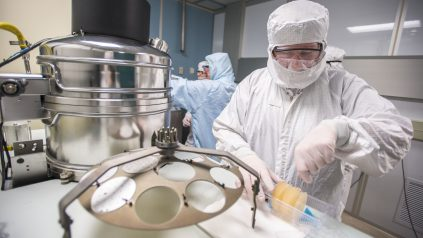 Scientists in clean room laboratory