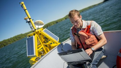 Researcher works on SeaNET bouy
