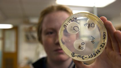 Student with Petri Dish