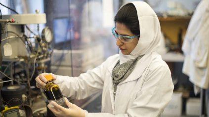 Researcher investigates vial of biofuel