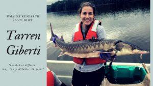 Tarren Giberti holds Atlantic sturgeon.