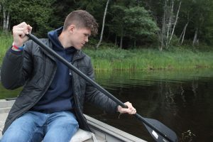 Nolan Altvater working on media documentation on the Penobscot River. Photo Credit: Tyler Quiring