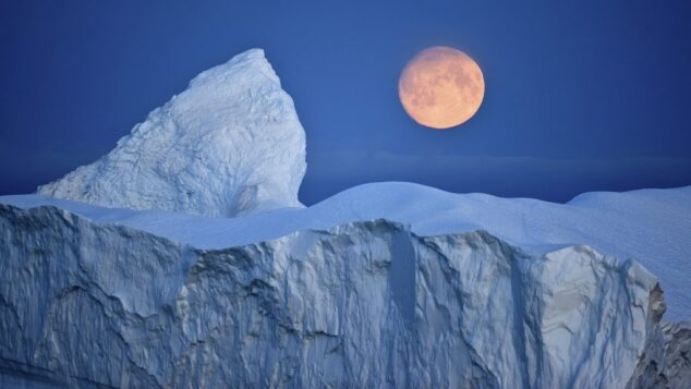 Moon and Arctic Background with Ice Caps