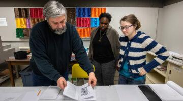 Photo of Vinzani workin with students