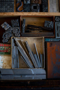 Photo of monotype ornaments sitting in a type drawer