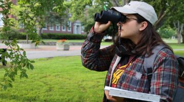 photo of student holding binoculars