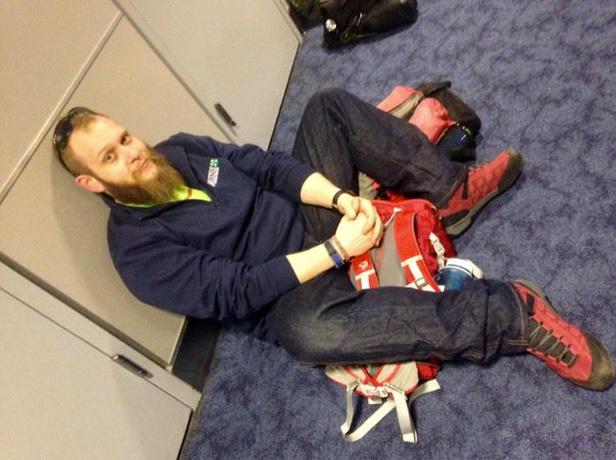 Charles Rodda waits for plane.