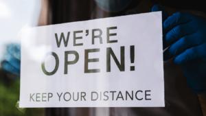 We're open sign on a door