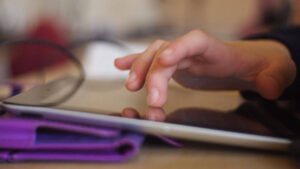 Hands using an iPad